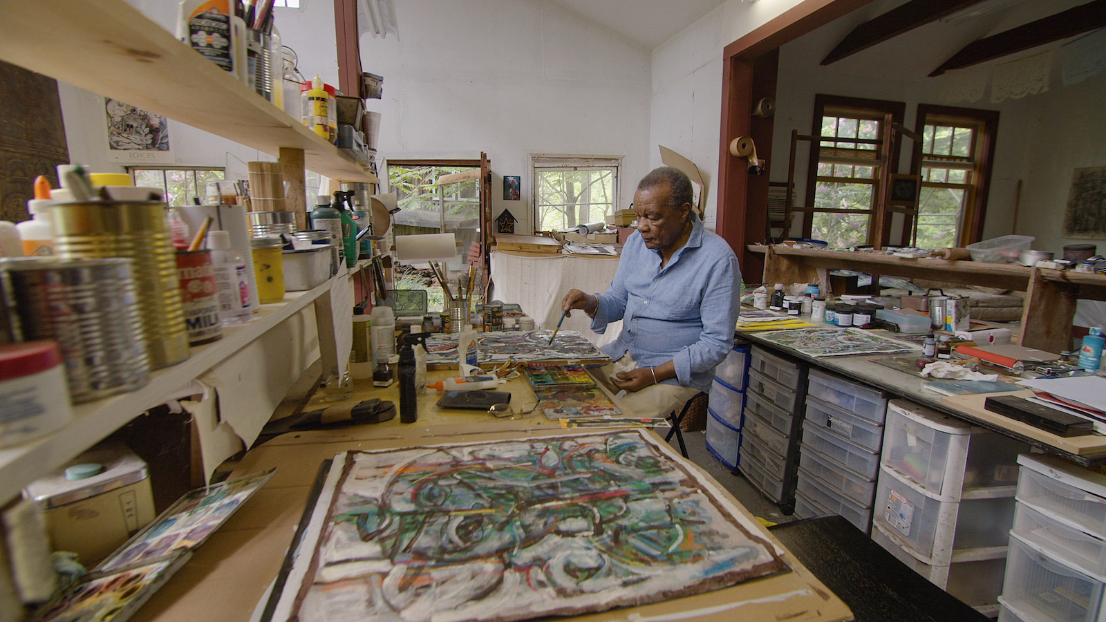 image of David Driskell painting in his studio